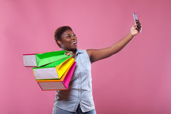 Selfie African American on a pink background royalty free stock photo
