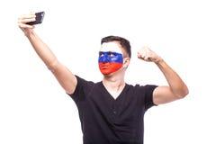 Selfie au téléphone des passionés du football russes dans le soutien de jeu des équipes nationales de la Russie Photos stock