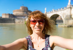 Selfie on the background of the Castel Sant`Angelo in Rome Stock Images