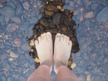 Selfie bare feet on the stones in the water royalty free stock photo