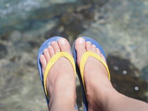 Selfie bare feet wearing colorful sandal over sea water backgrou Royalty Free Stock Photography