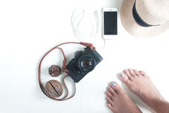 Selfie of barefoot with travel items, film camera, smartphone an Royalty Free Stock Photo