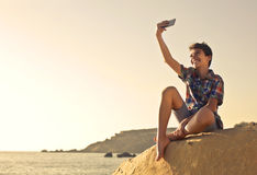 Selfie on the beach. Guy taking a selfie on the beach Royalty Free Stock Images