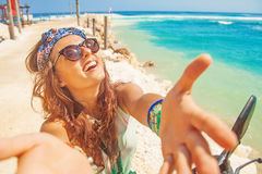 Selfie on a beach. Stylish selfie on a beach while riding a motorbike Royalty Free Stock Images