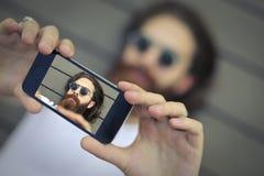 Selfie. Bearded man is taking a selfie Royalty Free Stock Photo