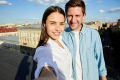 Selfie of beautiful couple on roof royalty free stock photo