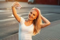 Selfie, Beautiful girl taken pictures of her self, instagram. Sunset stock photos