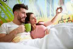 Selfie in bed together Royalty Free Stock Photography