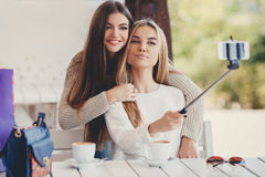 Selfie in a cafe two nice girlfriends. Royalty Free Stock Photo