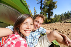 Selfie camping couple in tent taking self portrait Stock Photo