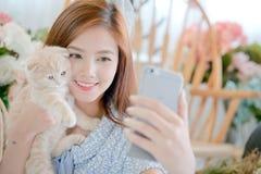Selfie cat with a cute little girl . Selfie cat with a cute little girl On a bright day Stock Photos