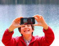 Selfie of a child with the background of Alpine Lake Royalty Free Stock Photography