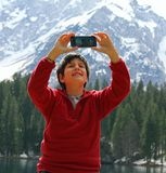 Selfie of a child with the background of dolomities Royalty Free Stock Photos
