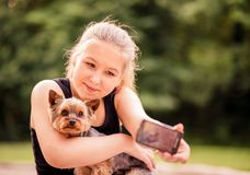 Selfie child and dog Royalty Free Stock Image