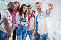 Selfie of college friends. College students making their selfie after lessons Stock Image