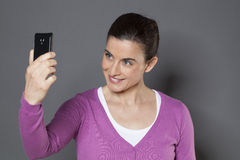 Selfie concept - young woman Stock Photography