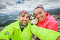 Selfie couple and dog in her arms royalty free stock photography