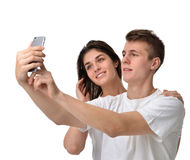Selfie couple taking pictures on mobile cell phone Stock Image