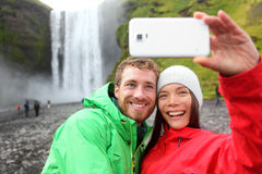 Selfie couple taking smartphone picture waterfall Stock Photography