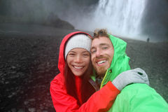 Selfie couple taking smartphone picture waterfall stock photos