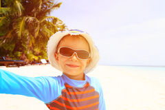 Selfie of cute happy little boy at beach Stock Image