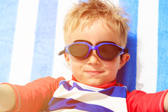 Selfie of cute happy little boy at beach Royalty Free Stock Image