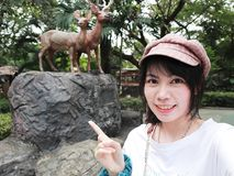 Selfie with deer statue at Dusit Zoo. royalty free stock image