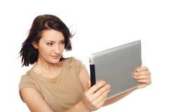 Selfie di presa femminile con la compressa digitale Fotografie Stock