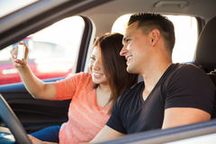 Selfie while driving a car Royalty Free Stock Image