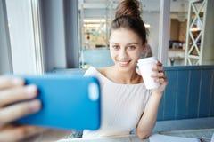 Selfie en café Imágenes de archivo libres de regalías
