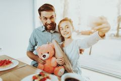Father congratulates his little daughter on the 8th of March. royalty free stock photo