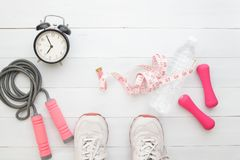 Selfie of feet sport shoes and fitness items measuring-tape and stock photos