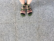 Selfie Feet Wearing Green Camouflage socks on Tile background Royalty Free Stock Photography
