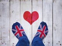 Selfie feet wearing socks with British flag pattern royalty free stock photos