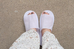 Selfie Feet Woman`s White Fluffy Slippers Standing Indoor On The Ground Royalty Free Stock Image