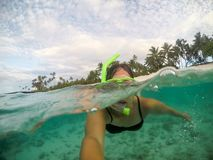 Selfie of a female woman tourist snorkelling at a beach at Matautu, Lefaga, Upolu Island, Samoa, South Pacific. Selfie of a female woman tourist snorkelling at a royalty free stock photo