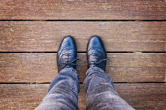Selfie of foot and legs with black derby shoes seen from above Royalty Free Stock Photography