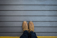 Selfie of foot and legs on wood Stock Photography