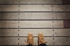 Selfie of foot with, you view the boots, rustic wood backgrou Royalty Free Stock Photography