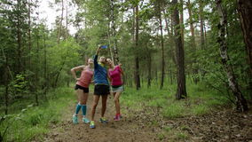 Selfie in the forest. Group of friends of young man and two women wearing sport clothes taking selfie in the forest stock video