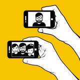 Selfie with friends - hand with smartphone Royalty Free Stock Photography