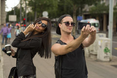 Selfie - friends taking photos of themselves on smart phone stock photos