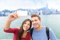 Selfie - friends taking picture in Hong Kong Royalty Free Stock Photos