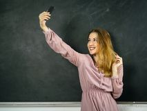 Selfie in front of a blackboard in class royalty free stock photography