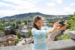 Selfie girl - Asian woman taking picture in Bern Stock Image