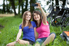 Selfie on a green glade. Taking a selfie on a green glade royalty free stock image