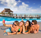 Selfie group of tourist friends in a tropical beach Royalty Free Stock Images