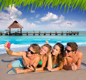 Selfie group of tourist friends in a tropical beach Stock Images