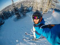 Free Selfie Guy Sportsman Goes On Normal Skiing On Ski Slope With Action Camera Sheregesh Stock Photo - 164069630