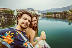 Selfie handsome relaxed couple resting near the lake . Excellent background . Royalty Free Stock Photos